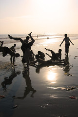 At Play (Life in AsiaNZ) Tags: china sunset beach silhouette tag3 taggedout sepia canon asian asia tag2 tag1 500v20f been1of100 chinese powershot ixus lookatme handstand    beihai  guangxi       1000v40f ultimate1   lifeinnanning flickrgiants