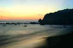 purity (Farl) Tags: longexposure travel sea beach water colors night bay coast sand rocks waves dusk philippines limestone gravel slowshutterspeed batanes baluarte batan coralstone