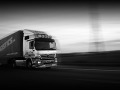 Longhaul (The Funky Lens) Tags: road travel blackandwhite motion blur truck pull lights mercedes highway traffic motorway dusk cab shift autobahn pylon route lorry chrome vehicle load artic tow carry articulated logistics