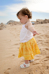 come pick me up, i've landed. (sesame ellis) Tags: vacation beach girl yellow mexico freedom sand cabo toddler joy mykid year2
