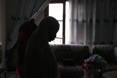 Evening prayer (blaine davis) Tags: life africa family blue light woman reflection dark evening women day apartment muslim islam prayer praying livingroom poweroutage senegal dakar bibi femmes sénégal ouakam blainedavis