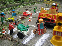 Playing in the street (Diana and Bart-Willem) Tags: street beer bench toy toys trafficlight doll dolls traffic roadworks wheelchair firetruck zebra pedestrians kermit enkhuizen playmobil playmobiel crossover clicks speelgoed zebrapad matchpoint