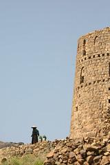 Woman in front of a tower - Yemen (Eric Lafforgue) Tags: republic arabic arabia yemen arabian ramadan yemeni yaman arabie jemen lafforgue arabiafelix  arabieheureuse  arabianpeninsula ericlafforgue iemen lafforguemaccom mytripsmypics imen imen yemni    jemenas    wwwericlafforguecom  alyaman ericlafforguecomericlafforgue contactlafforguemaccom yemenpicture yemenpictures