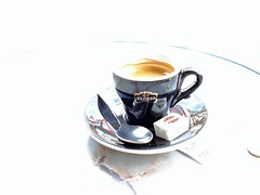 A cup of caf (Julie70) Tags: blue paris cup tasse caf photos spoon 2006 images negativespace mostinteresting instant pointshoot onthestreet myfavs frhstck happyaccidents cafee flickrfavs mostviewed petitdjeuner mostfav julie70 topfavs copyrightjuliekertesz reggeli photojuliekertesz juliekertesz bigfavs flickrmostfavorited mypreferred 100mostinteresting cupofcafe 120of50000