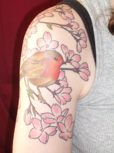 Robin's tattoo of a robin, suitingly enough; ← Oldest photo