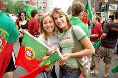 A Smile For Portugal (austinhk) Tags: world street girls red baby canada cars cup portugal face saint festival del football tv nikon montral d70 quebec nikond70 plateau montreal fifa painted soccer d70s reporter young hats 2006 du flags wm menschen parade shirts qubec fans cheer win worldcup nikkor monde der celebrate coupe crowds mundo copa laurent portugese coupedumonde worldcup2006 falgs copadelmundo austinhk austink