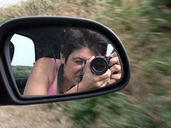 A Quickie for the road (Magali Deval) Tags: selfportrait me car speed myself mirror europe narcissism sideview panasonicfz5 lampaulploudalmezau