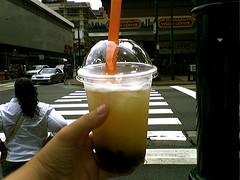 I heart bubble tea (ShimmeeGrrl) Tags: cameraphone street vacation orange philadelphia cup yummy bubbletea hand tea drink beverage straw plastic delicious bubble thumb crosswalk