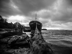 Tied ship (ANDMIK) Tags: white black water norway canon eos blackwhite ship vessel rope hordaland 2015 nd400 60d canoneos60d tiedship