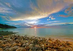 Borneo Sunset. (iainwitheyes) Tags: light sunset sea sun mountain beach clouds seaside rocks asia ray glory sarawak malaysia borneo rays colourful southeast hdr damai