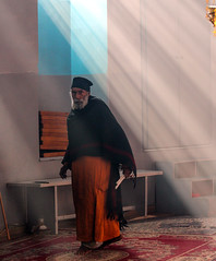 Hope in the coming year we shall see the light (ybiberman) Tags: israel jerusalem ethiopianchurch man priest beam light candles candid streetphotography