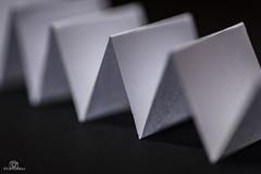 Just White Paper - MM (CamraMan.) Tags: justwhitepaper macromondays macromonday a4 canon6d tamron90mm folded ©camraman mm triangle paper white black wow