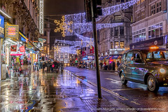 Coventry Street off Leicester Square (Splendid What) Tags: bookofmormon cab christmasdecorations christmaslights coventrystreet fb london londoncab nightscene nightshot pavementreflections princeofwalestheatrelondon rain regentstreet taxi taxicab wet xmaslights