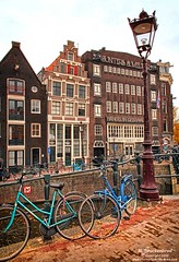 Bikes and Dutch buildings on the Prinsengracht, Amsterdam (PhotosToArtByMike) Tags: prinsengracht canal jordaan amsterdam bikes bicycles dutchbuildings canalring canalhouse grachtengordel netherlands dutchgoldenage dutch holland