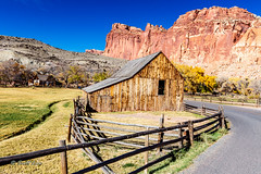 Fruita Barn (Just Used Pixels) Tags: torrey utah unitedstates us capitolreefnationalpark barns fences pastures redrock mountains formations
