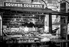 Keepin 'Er Country.....   [Explored] (RonnieLMills) Tags: country music seller vendor soundscountry mono bw blackandwhite street photography conway square newtownards county down northern ireland explore explored 22117 259