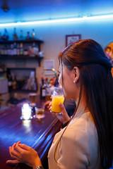 Lovely lady drinking orange juice in bar with smile (Apricot Cafe) Tags: people japan night asian japanese togetherness couple sweet weekend lifestyle happiness dating yokohama lovely kanagawa 2people pleasant kanagawaken yokohamashi modelshooting canonef1635mmf28liiusm img614971