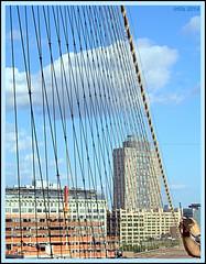 The sky through Harp Strings (Irina Kiseleva) Tags: sky bridge cloud building hand repetition composition photoborder color blue red white beige shadow 1001nights manhattan