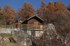 en attente du printemps prochain... (bulbocode909) Tags: valais suisse isrables cabanes rochers arbres mlzes automne nature montagnes orange bleu escaliers barrires balcons