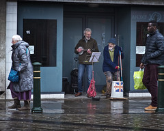 Singing in the rain (JEFF CARR IMAGES) Tags: northwestengland greatermanchester towncentres buskers drizzle wet