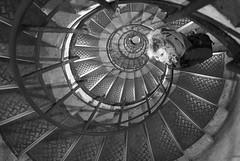 Hannah @ The Arc de Triomphe (tim jg photography) Tags: stairs happy smile blackandwhite model lady girl descending climbing steps metal shiny shadow dark shade handrail roundandround dizzy