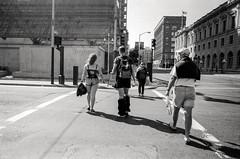 honey (Super G) Tags: blackandwhite bw woman man film walking streetphotography corset fishnets kodaktmax100 olympusom4 d7695mins68d11 imsuretherewasareasonfortheircostumes ijustcouldntfigureitout 20150619om4tmax100