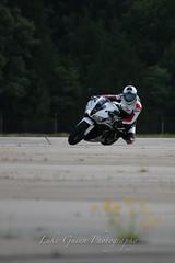V51A1952 (lgphotoshare) Tags: race speed honda fun outdoor scooter triumph motorcycle sportbike wheelie stunts cbr shoei speedtriple kneedragging 7dmkii ef70200ismkii