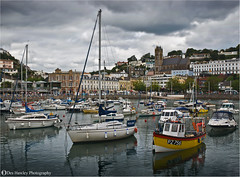 OVERCAST (Des Hawley. Over 1.7 million views !!) Tags: uk sea england sky church water beautiful rain marina buildings boats grey boat seaside nikon sailing waterfront cloudy harbour outdoor gorgeous photojournalism resort devon shops sultry yachts torquay heavy southcoast dull archtecture greyskies coth d80 englishriviera platinumpeaceaward coth5 deshawley cothgoldgallery thegalaxyhalloffame thegalaxystars