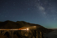 Bixby Bridge by Night (twinsfan7777) Tags: ocean california bridge trees cliff moon mountain fish tree cars beach nature water grass car rock stone by architecture night america way stars point landscape outside outdoors one star coast monterey highwayone fishing sand highway rocks long exposure arch pacific outdoor stones space hill sigma landmark astro trail astrophotography carmel land milky bixby bixbybridge naturephotography pacificcoasthighway landscapephotography malibou canoneosrebelt2i canoneosrebel550d sigma1770mmf284oshsmc
