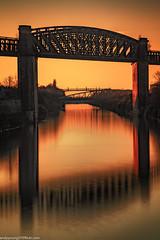 Latchford Locks (3 of 8) (andyyoung37) Tags: latchfordlocks manchestershipcanal reflections uk warrington bridge cheshire oldrailwaybridge orangesky sunset