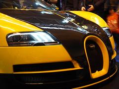 Bugatti Veyron Autosport International Show 2017 (Hammerhead27) Tags: sparkles carbonweave hypercar display crowd 2017 birmingham nec show international autosport oakleydesign badge grille light front black yellow bugattiveyron