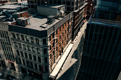 It Takes Courage to Stand Alone (Alexander Tran | atranphoto.com) Tags: above street city light boston downtown alone cityscape arch crossing massachusetts garage parking mass harsh atran atranphoto