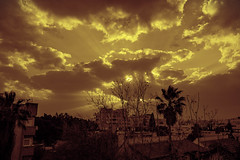 The Source (Ivona & Eli) Tags: roofs houses rays sun clouds sunset middleeast israel raanana