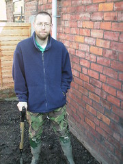 A 116 (rugby#9) Tags: rubber boots rubberboots wellingtons wellies green hunters size8 8 buckles muddy muddyboots hunter hunterboots dirt garden fence spade shovel bricks wall camoflagetrousers trousers camoflage combats fleece blue bluefleece mud