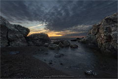 . (biondot) Tags: sea sunset tripleexposure tripod scogliodellaballerina seascape dramaticskye wideangles grandangolo clouds canon7d sigma1020mmf456exdc sigma1020mm sigma1020mmf456 tuscany tramonto livorno scogliera rocks nuvole italia digitalblending exposureblending