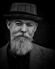 Mick (Pat Kelleher) Tags: portrait bw white black face hat noiretblanc character grain portraiture