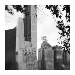 NYC 7 ( CHRISTIAN ) Tags: nyc urban blackandwhite bw usa ny newyork monochrome skyline architecture lensbaby skyscraper square nikon noiretblanc centralpark manhattan nb carr urbain essexhouse tatsunis