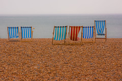 Another sunny day on Brighton Beach (hattiebella) Tags: city uk sea holiday english beach water sussex coast seaside brighton waves chairs cloudy empty south horizon great windy overcast deck pebble pebblebeach british lonely stripey deckchairs englishchannel typicalbritishweather brtish blindphotographer visuallyimpairedphotographer greatbritishholiday viphotography wishingitwassunny stripeydeckchair hattiehall