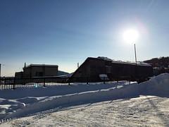 Shadows on the Snow in a Parking Lot 1 (sjrankin) Tags: 21january2017 edited yubari hokkaido japan shimizusawa sun shadows parkinglot buildings