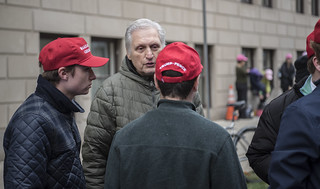 Martin Gugino Converses with Donald Trump Supporters Outside the 2017 Presidential Inauguration