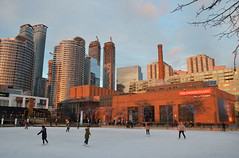 Afternoon skate (mcfcrandall) Tags: skating natrelpond ice people lateafternoon lowsun rink toronto skyline harbourfront downtown buildings urban outside powerplant skyscrapers condos sky reflections glass