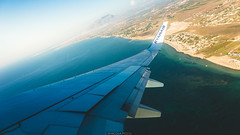 Above the beach (Nicola Pezzoli) Tags: favignana trapani sicilia sicily island egadi summer sea water colors nature canon tourism airplane ryanair wing beach blue fly glow