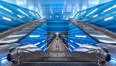 Überseequartier (fotobagaluten.de) Tags: underground architecture metro ubahn hamburg hafencity urban rolltreppe kacheln treppe stairs escalator blue lights neon steel stahl platform city