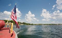 Stern Flag (heightsfidelity) Tags: water minnesota clouds zeiss stars stripes flag united 4th july wideangle contax wa states mn manualfocus distagon wayzata lakeminnetonka 28f28 steamboatminnehaha
