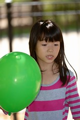 Little Chinese girl  with a green balloon (adamba100) Tags: life china street city trip travel light boy portrait people woman man color colour cute male men tourism lamp girl beautiful beauty face female children landscape asian person star town canal kid interesting women asia pretty vietnamese cityscape child play view outdoor innocent sightseeing chinese decoration beijing lifestyle style charm korea headshot tourist vietnam mongolia korean human thai innocence lantern gadget pure channel pendant purity mongolian