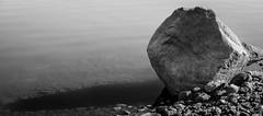 The Boulder (taggartgorman) Tags: camping blackandwhite water rocks loonlake