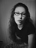 P00158 (EYEsnap_Photography) Tags: blackandwhite brunette curlyhair eyewear glasses portrait jade