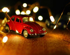 New Year is not only about festive frivolities, but also hope in the fulfillment of our deepest dreams. (shadman ali) Tags: lights warm bangladesh dhaka shadman shadmanphotography car toy nofilter stm 50mmstm 50mm t5i canont5i canon700d canon bokehlicious dof bokeh newyear2017 2017 beetle volkswagen volkswagenbeetle happynewyear