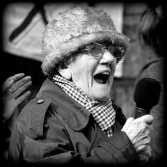 Firebrand (* RICHARD M (Over 5.5 million views)) Tags: candid street portraits portraiture candidportraits candidportraiture streetportraits streetportraiture mono blackwhite firebrand protester protests demonstrator demo rally demonstration publicspeaking mike mic derbysquare victoriamonument liverpool merseyside liverpudlians scousers oap oldagepensioner pensioner senior orator oratory militant militancy bedroomtax austerity thecuts specs glasses eyeglasses spectacles furhat passion oldlady oldergeneration elderlylady publicspeaker politics politico socialism socialist rallies fiesty