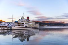Hibernation (Joyce and Steve) Tags: lakegeorge upstatenewyork lake sunrise reflection cruiseboat winter autumn fall